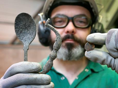 Carl Higgins holding a spoon, a drawer handle and a coin which were recovered in the non-ferrous collector from the waste incinerator at the Indaver plant at Duleek, Co Meath