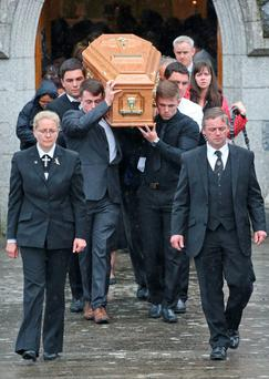The remains are carried from church after the funeral of Orla Curry (20), who was one of three people killed in a car crash in Co Laois. Her funeral took place at St. Canice's Church, Clough