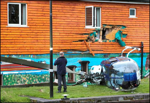 The helicoper lying on its side on the bank of the Royal Canal beside the Rustic Inn in Abbeyshrule, Co Longford