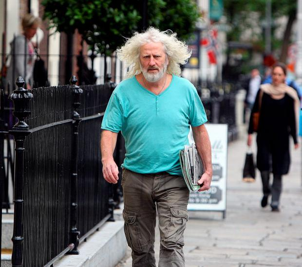 Mick Wallace arrives at Leinster House yesterday