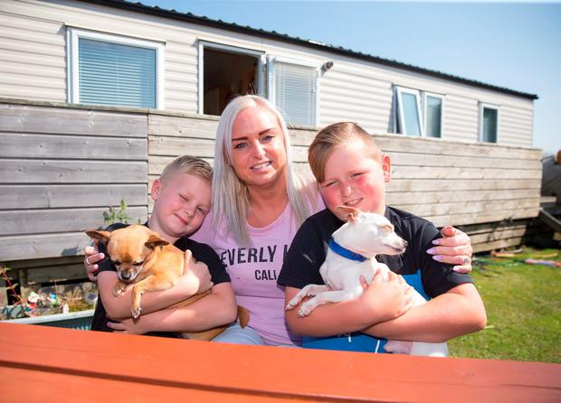 Jeannine Burke with her sons Karl (7) and Evan (8) and their dogs Ollie and Lola at Arklow Holiday Park, Co Wicklow