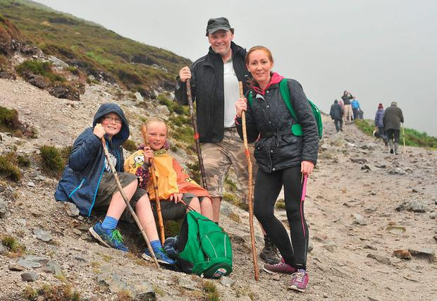 Pascal and Dympna Manley with their children Oisin and Blathnaid from Roslea, Co Fermanagh, on their way to the summit of Croagh Patrick yesterday