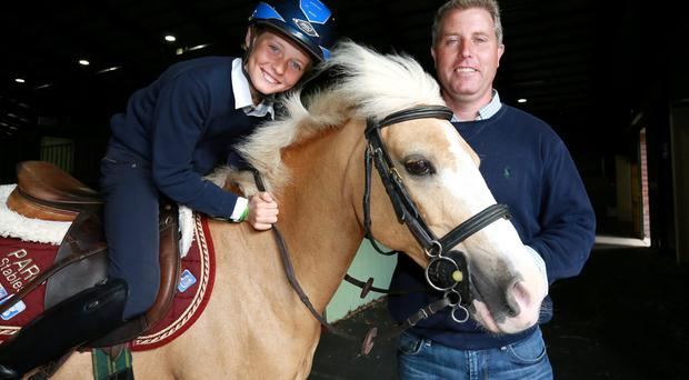 Ten-year-old Rhys Williams from Ennis, Co Clare, with his pony Norah and his father Adrian