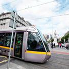 A Luas travels across O'Connell Street yesterday