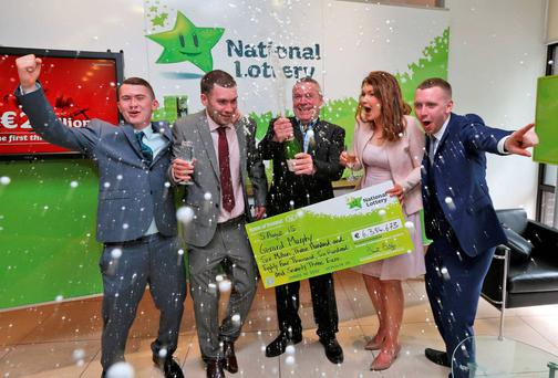 Lotto winner Ger Murphy (centre) from Ballinrobe, Co Mayo with his children (from left) Jack, Ger, Laura and Dave at Lotto HQ in Dublin yesterday where he collected his winnings