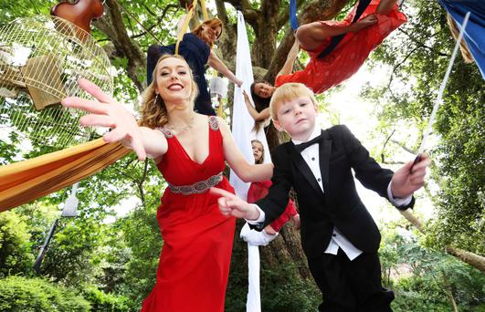 Opera singer Aoife Gibney and aerial artists Ria Murphy (top left) and Salla Vartia (top right) from Aerial Cirque launched the programme of events for Culture Night 2015 in Merrion Square Park, Dublin, yesterday with a little help from young conductor Cillian Byrne (6) and Sophie Deegan (7), centre.