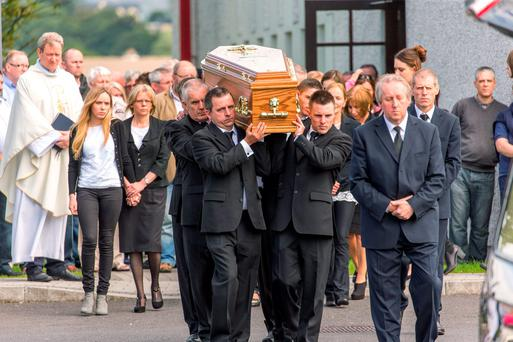 Relatives and friends carry the coffin of Martin 'Matt' Kivlehan (left) from St Joseph's Church in Sligo yesterday
