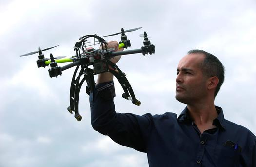 David Yaffe looks at his drone at Weston Aiport where The Unmanned Aircraft Association of Ireland (UAAI) held an open day to broaden knowledge and awareness of the industry in Ireland including regulation, enforcement, data protection and privacy