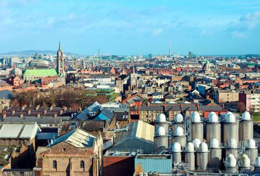 View over Dublin with a part of it's famous brewery in the front.