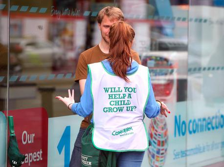 A Concern Charity worker attempts to get a person to support the charity