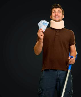 Disabled Man With Neck Brace Holding Euro Note Isolated On Black Background