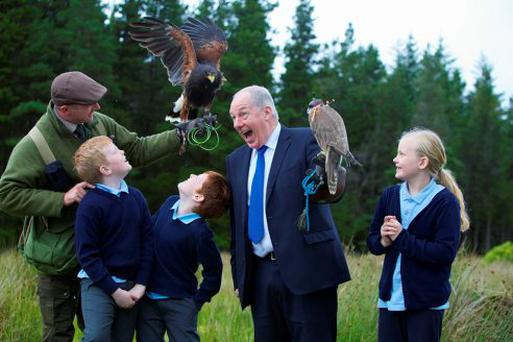 Tourism Minister Michael Ring with pupils of Scoil Nephin National School at the opening of the first phase of visitor access facilities at a project to create an 11,000-hectare wilderness landscape in Co Mayo