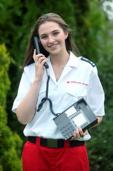 Irish Red Cross Worker, Emily Guilfoyle at the launch of the new Irish Red Cross hotline number for resettlement services for refugees