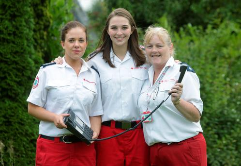 Irish Red Cross workers, Gina O'Dwyer, Emily Guilfoyle and Ruth Mahon, at the launch of the new Irish Red Cross hotline number for resettlement services for refugees