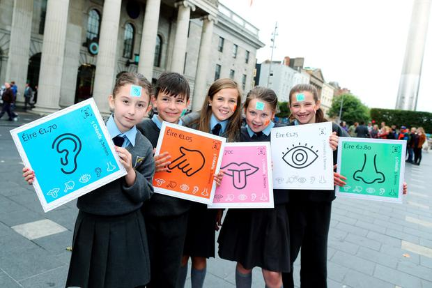Tamzin Kelly, Stefan Perju, Tia Fitzgerald, Aliyah Flood and Mary Stokes(10) and Aliyah Flood(10) from the Central Model Primary School in Marlborough Street, Dublin at the launch of the stamps