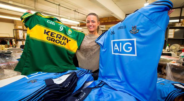 Gabriella Visockiene with the Dublin and Kerry jerseys at the O'Neills factory at Walkinstown yesterday