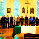 Members of the public view the coffin containing the remains of Thomas Kent in St Michael's Garrison Church, Collins Barracks, Cork, ahead of today's state funeral in St Nicholas' Church, Castlelyons, and re-interment in the family plot