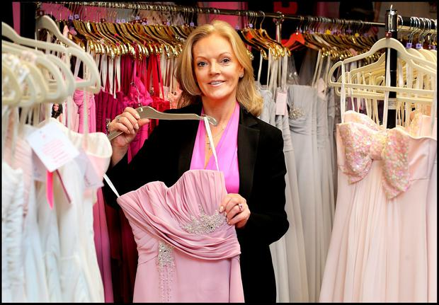 Marian Gale with a selection of Debs dresses at her boutique in Donnybrook