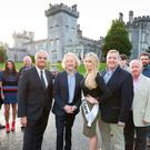 Up the Banner: Barry Egan (centre) with from left Jackie Whelan of West Clare Railway; Stephen McDermot, Clare FM; Timmy Dooley TD; Roisin McMahon, Clare camogie; Mark Nolan, general manager Dromoland; Miss Clare Elaine Galvin; Pat Breen TD; Mikey O'Loughlin, RSVP; Cllr Gabriel Keating; Johnny Hassett, Ballyhannon House; Deirdre Keating, Dromoland, at Dromoland Castle, Co Clare