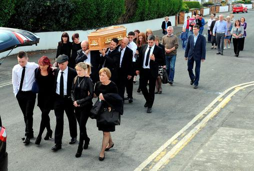The late Julie Healy-Rae is brought from her home in Killarney for reposing at O'Shea's Funeral Home, Killarney, by mourners including Julie's sons Deputy Michael Healy-Rae TD and Cllr Danny Healy-Rae