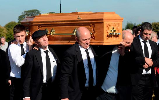 Carrying the remains of Julie Healy-Rae (pictured right) at her funeral in St Mary's Cathedral, Killarney, were (from left): grandson Jack and sons Michael, Denis and Danny Healy-Rae