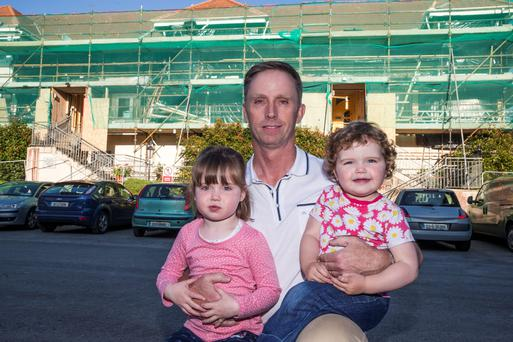 Joe Quinn and his daughters Olivia (3) and Hayley (2) at their home at Riverwalk Court in Ratoath, Co Meath. Photo: Arthur Carron