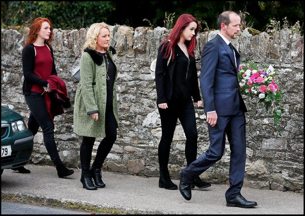 Mourners arrive for the removal of Cathriona White at White's Funeral Home in Cappawhite in Tipperary