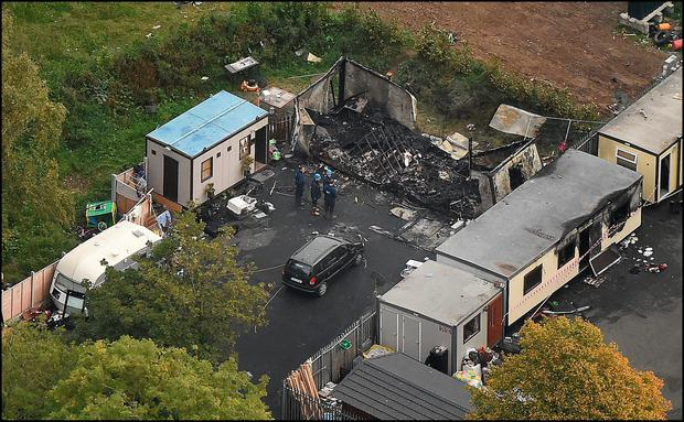 DEVASTATION: An aerial photograph shows the utter devastation at the scene from the halting site of the tragic fire at Glenmaluck Road, Carrickmines, that claimed the lives of 10 people Credit: David Conachy