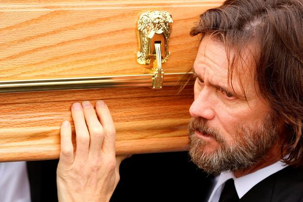 GRIEF: Hollywood actor Jim Carrey pictured carrying the coffin of his former girlfriend Cathriona White