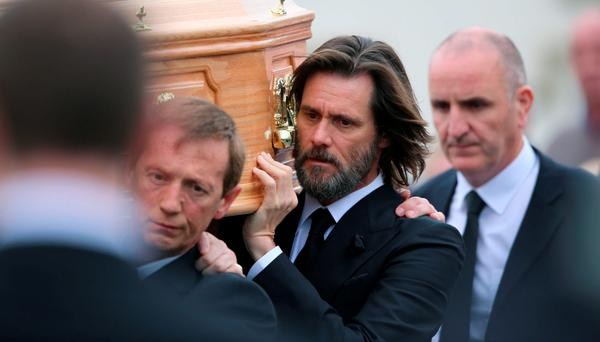 Jim Carrey carries the coffin of ex-girlfriend Cathriona White ahead of her funeral in Cappawhite, Co Tipperary