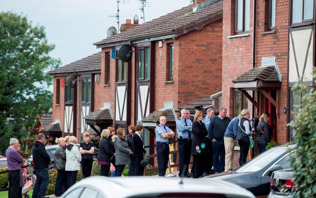 Friends and colleagues pay their respects at the house of murdered Garda Tony Golden in Blackrock, Co Louth