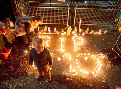 Mourners light candles in memory of the 'Carrickmines 10' who died in the tragedy last weekend