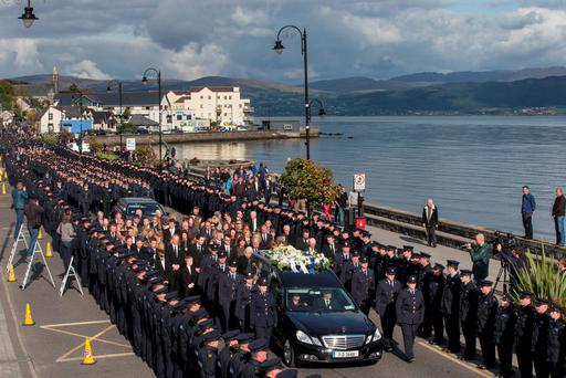 The remains of the Garda Tony Golden are brought from St Oliver Plunkett Church in Blackrock, County Louth after his State Funeral