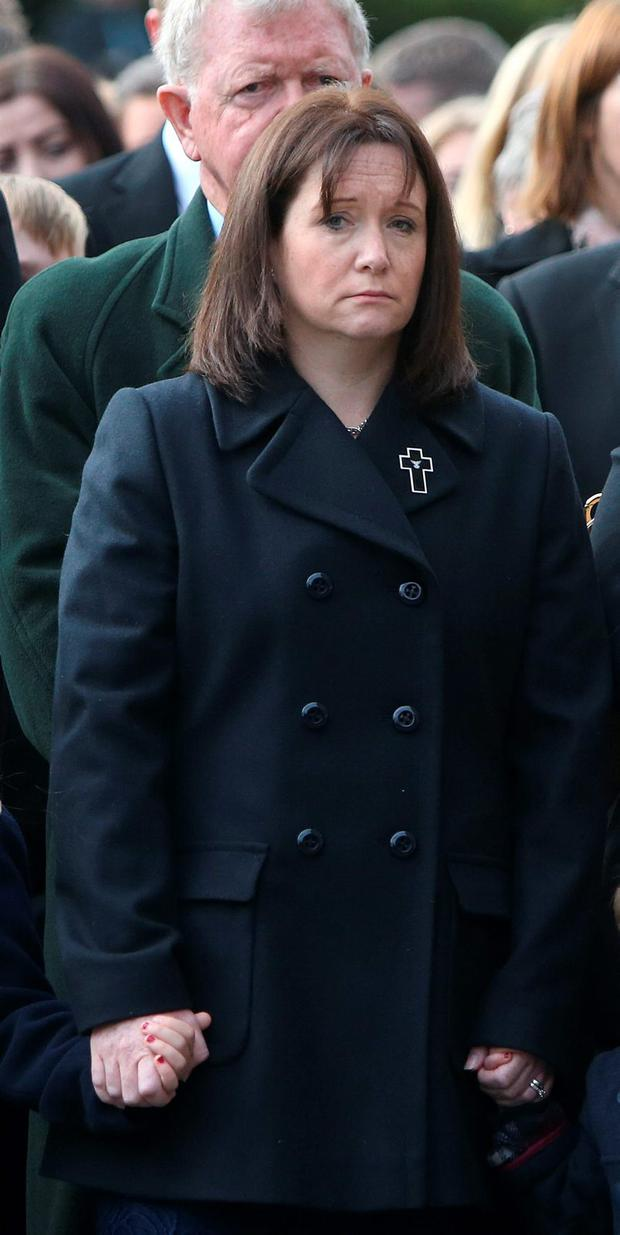 Garda Tony Golden's wife Nicola attends his funeral at St Oiver's Church in Blackrock, Co Louth