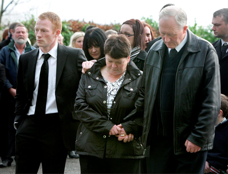 Gary McLoughlin's mum Una, dad Noel and brother Enda at his funeral Mass at St Mary's Church, Foxfield Co Leitrim in 2009
