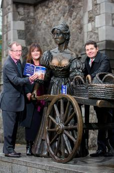 At the Molly Malone Statue in Dublin were Niall Gibbons, CEO of Tourism Ireland; Noirín Hegarty, Lonely Planet; and Tourism Minister Paschal Donohoe as they announced Dublin has been named one of the top cities in the world to visit in 2016 by Lonely Planet