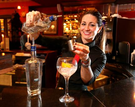 Camila Oliveria pours a gin in the Gin Palace on Abbey Street in Dublin