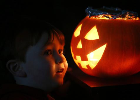 Three-year-old Odhran Keegan from Lucan, Dublin, with his Jack O'Lantern.