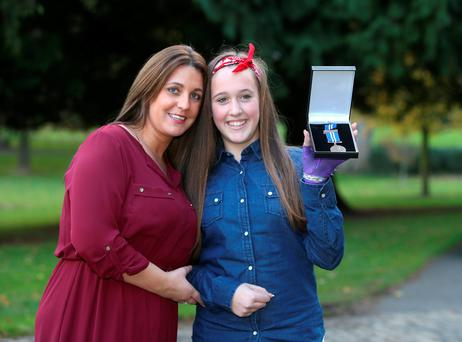 Roisin Halligan, 12, who received a bronze medal, with her aunt Danielle Halligan, in Farmleigh House