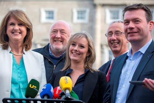 Newly-elected Senator Mairia Cahill pictured with Tánaiste Joan Burton and Minister Alan Kelly outside the Dail this evening