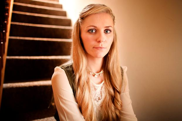Emma Murphy who was a victim of domestic violence pictured on the stairs in her home where she delcared to the world via a video on social media that she was getting abused. Photo: Gerry Mooney