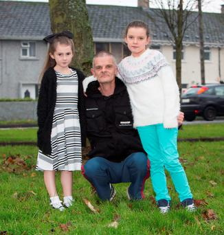 Alan Hannan with his two grandaughters Tianna (7) and Nikita (9). His son Jeffrey died after an unprovoked attack near his home in Limerick in November 2007