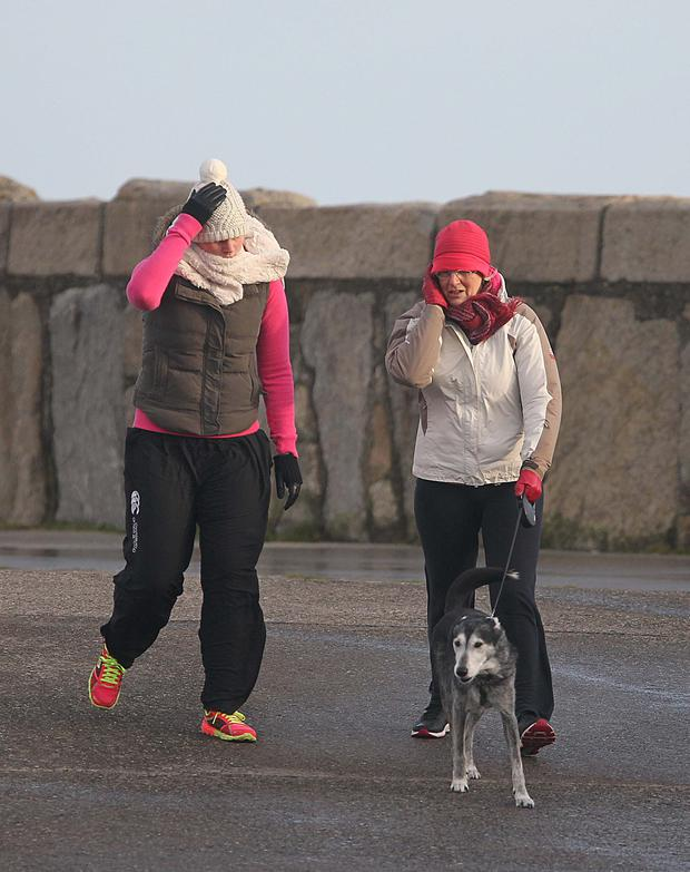 Hold on to your hat...walkers braved the weather at Dun laoghaire pier