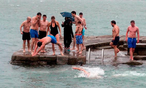 ICY DIP: Dozens of brave souls taking part in the annual Christmas Day swim at the Forty Foot in Sandycove, Dublin. Photo: PA