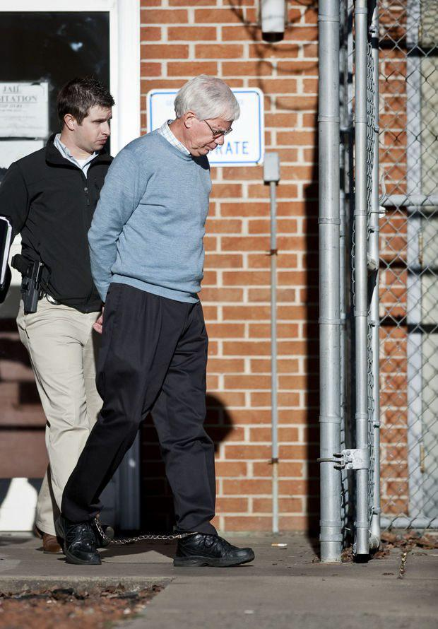 Thomas Martens is led out of the Magistrate's Office at the Davidson County Courthouse. Photo: Lauren Carroll/Winston-Salem Journal
