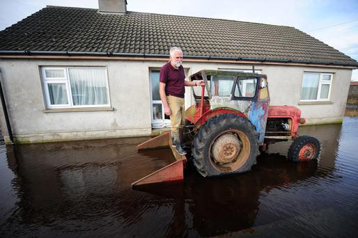 John Doolan on his tractor, his only means of transport while his home is flooded, in Cush, Pollough, Co Offaly.
