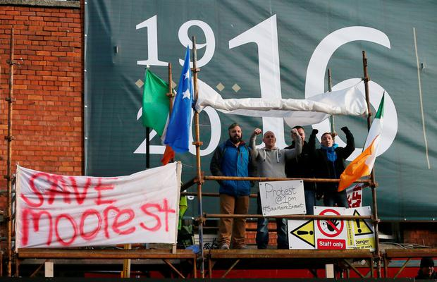 Last week, workers on the site were forced to down tools after protesters entered into 14-17 Moore Street and expressed their concerns about several protected structures on the terrace being damaged as a result of demolition work. Photo: PA