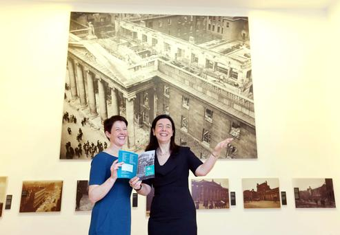 Curator Sara Smyth and Dr Sandra Collins at the National Photographic Archive