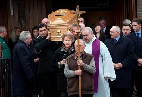 The coffin of Kenneth O'Brien is taken from the chuch of St. Matthew in Ballyfermot. Photo: Tony Gavin
