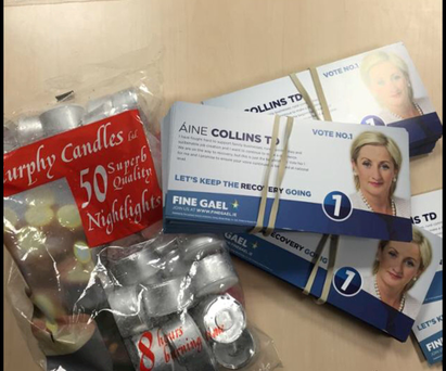 Aine Collins handed out candles to homes.